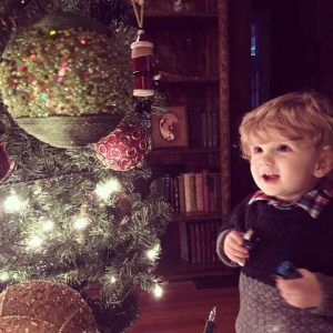 Small child gazing in awe at a Christmas Tree